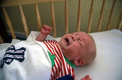 Baby crying in cot UK