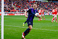 Luton Town forward James Collins (19) scores a goal from the penalty spot and celebrates to make the score 2-1 during the EFL Sky Bet League 1 match between Barnsley and Luton Town at Oakwell, Barnsley, England on 13 October 2018.