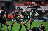 Adam Thompstone of the Tigers © goes past the tackle from Ospreys no 9 Kahn Fotuali'i. Heineken cup rugby, pool 2, Ospreys v Leicester Tigers at the Liberty Stadium in Swansea, South Wales on Sunday 13th Jan 2013. pic by Andrew Orchard, Andrew Orchard sports photography,