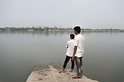 Boys waiting for the boat, region of Dacope, Southern Bangladesh.