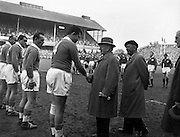 Ireland's president Sean T O'Kelly, greeting the Captain of the French team, L Mias, number 4, before the Ireland v France International Rugby match at Landsdowne Road, Dublin, on Saturday 18th April, 1959,.The President of the French Rugby Union, Mr Rene Crabos is on the right,..Irish Rugby Football Union, Ireland v France, Five Nations, Landsdowne Road, Dublin, Ireland, Saturday 18th April, 1959,.18.4.1959, 4.18.1959,..Referee- D G Walters, Welsh Rugby Union, ..Score- Ireland 9 - 5 France, ..Irish Team, ..N J Henderson, Wearing number 15 Irish jersey, Full Back, N.I.F.C, Rugby Football Club, Belfast, Northern Ireland, ..A J O'Reilly, Wearing number 14 Irish jersey, Right Wing, Old Belvedere Rugby Football Club, Dublin, Ireland, and, Leicester Rugby Football Club, Leicester, England, ..M K Flynn, Wearing number 13 Irish jersey, Right Centre, Wanderers Rugby Football Club, Dublin, Ireland, ..D Hewitt, Wearing number 12 Irish jersey, Left centre, Queens University Rugby Football Club, Belfast, Northern Ireland,..N H Brophy, Wearing number 11 Irish jersey, Left wing, University College Dublin Rugby Football Club, Dublin, Ireland, ..M A F English, Wearing number 10 Irish jersey, Outside Half, Bohemians Rugby Football Club, Limerick, Ireland,..A A Mulligan, Wearing number 9 Irish jersey, Scrum Half, London Irish Rugby Football Club, Surrey, England, ..B G Wood, Wearing number 1 Irish jersey, Forward, Garryowen Rugby Football Club, Limerick, Ireland, ..A R Dawson, Wearing number 2 Irish jersey, Captain of the Irish team, Forward, Wanderers Rugby Football Club, Dublin, Ireland, ..S Millar, Wearing number 3 Irish jersey, Forward, Ballymena Rugby Football Club, Antrim, Northern Ireland,..W A Mulcahy, Wearing number 4 Irish jersey, Forward, University College Dublin Rugby Football Club, Dublin, Ireland, ..M G Culliton, Wearing number 5 Irish jersey, Forward, Wanderers Rugby Football Club, Dublin, Ireland, ..N Murphy, Wearing number 6 Irish jersey, Forward, Cork Constitution