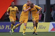 Chris Zebroski of Newport County ® celebrates after scoring his side's injury time equaliser to make it 2-2.  Skybet football league 2 match, Newport county v Scunthorpe Utd at Rodney Parade in Newport, South Wales on Saturday 1st March 2014.<br /> pic by Mark Hawkins, Andrew Orchard sports photography.