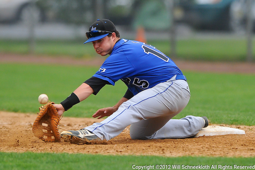 Hammonton first baseman Branon Kincaid is unable to handle relief pitcher Justin Smith's (not pictured) throw to first, allowing Freehold Boro's winning run to score in extra innings during NJSIAA Group III baseball semifinal action between Hammonton High School and Freehold Boro High School at Monmouth University..Photo/Will Schneekloth special to The Daily Journal
