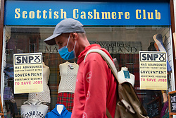 Edinburgh, Scotland, UK. 10 June 2021. With few overseas tourists in Edinburgh because of Coronavirus travel restrictions, many tourist shops on the Royal Mile are closed or suffering financial difficulties. Many have put signs in windows accusing the SNP Scottish Government of not doing enough to help save jobs. Pic; Signs attacking SNP in tourist shop window on Royal Mile. Iain Masterton/Alamy Live News