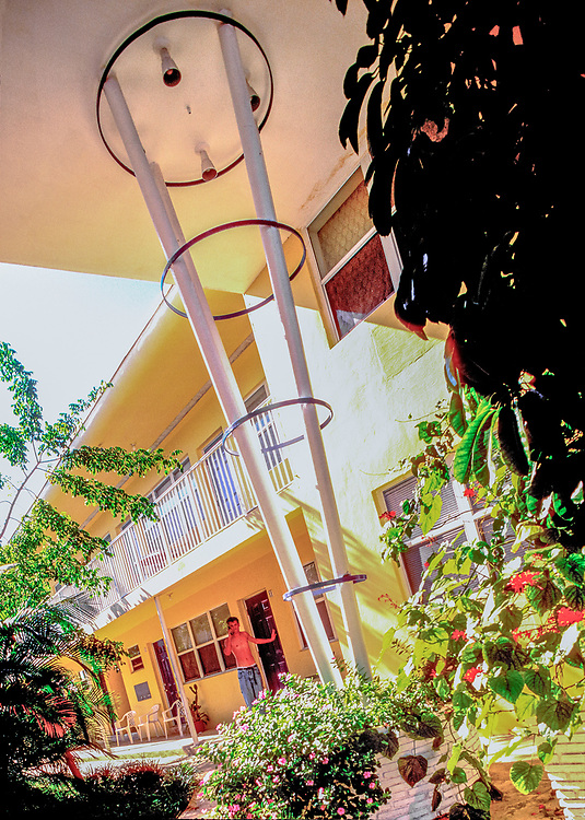 """A Miami Modern garden apartment building in Miami Beach's North Beach neighborhood features a """"beanpole"""" structure typical of the style."""