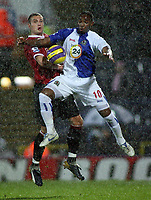 Photo: Paul Thomas.<br /> Blackburn Rovers v Manchester United. The Barclays Premiership. 11/11/2006.<br /> <br /> Benni McCarthy (10) of Blackburn and Nemanja Vidic go for the ball.