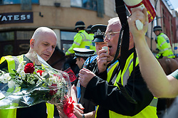 An EDL organised event to lay flowers at Sheffields War Memorial in Barkers Pool in Memory of Lee Rigby on Saturday afternoon was stopped by supporters of Sheffield Unite Against Fascism and One Sheffield Many Cultures. <br /> In an attempt at a compromise Father Shaun Smith, Chair One Sheffield Many Cultures puts forward a South Yorkshire Police offer to have a single officer lay the flowers but the plan breaks down when Minor scuffles break out as police attempt to keep the two groups apart.<br /> 1 June 2013<br /> Image © Paul David Drabble<br /> www.pauldaviddrabble.co.uk