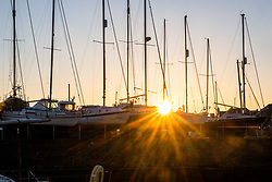 © Licensed to London News Pictures. Aberystwyth Wales UK,  26/02/2019. Daybreak over boats moored at Aberystwyth harbour , Ceredigion West Wales, on yet another day of clear skies. Yesterday the area around the town experienced the hottest ever recored February temperatures in the UK, reaching 20.3ºc at Trawsgoed. 