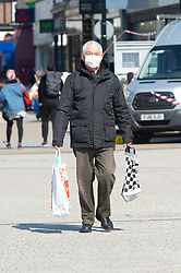 ©Licensed to London News Pictures 27/03/2020  <br /> Bromley, UK. A busy Bromley high street today as this man wears his mask. The Prime Minister Boris Johnson has asked people to stay at home to help in the fight against Covid-19 and to only go out for essential reasons. credit:Grant Falvey/LNP