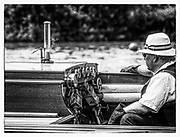 """Henley. Berks, United Kingdom. 17th June 2017, Steam Launch, """"Consulta"""" """"The Stoker/Engineer,"""" keeps an eye on the Dials, during a race at the 2017 Henley' Women's Regatta. Rowing on, Henley Reach. River Thames. <br /> <br /> <br /> """"Film Noir Style Photography"""", © Peter SPURRIER"""