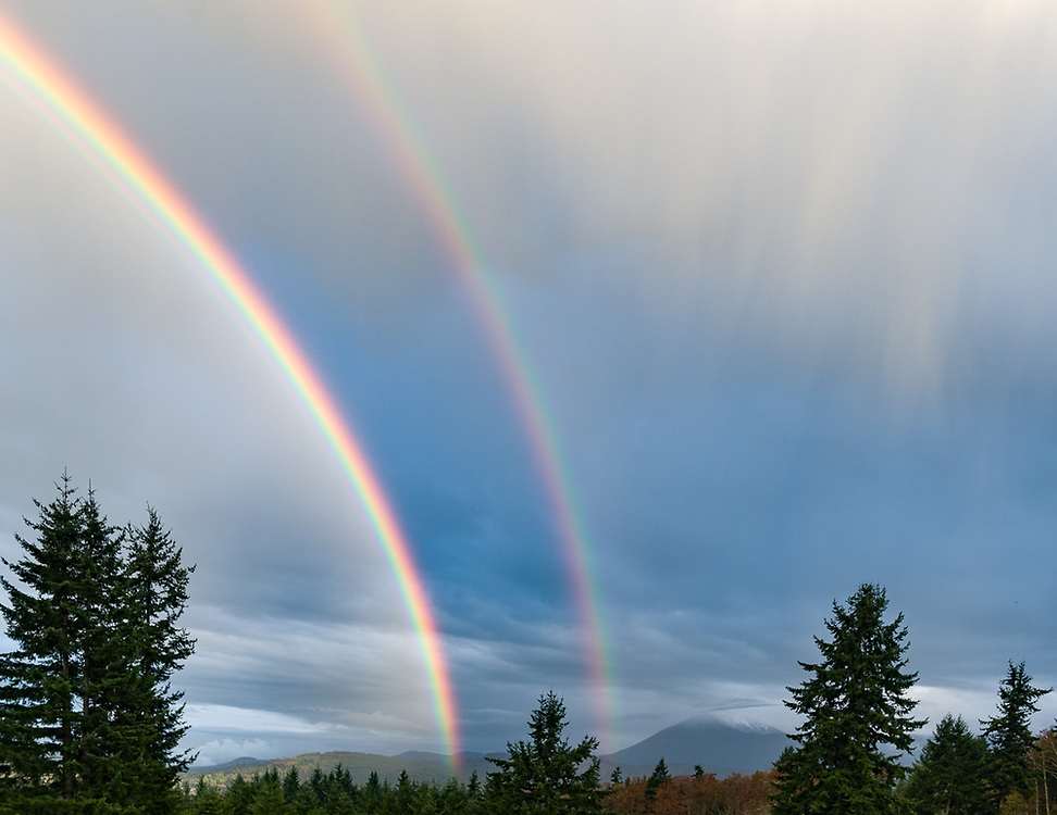 Double rainbow, late winter, view toward Blue Mountain in Olympic National Park from Mount Pleasant, North Olympic Peninsula, Washington, USA