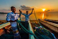 Fishermen inspecting their nets at sunrise, Kinniya (near Trincomalee), Eastern Province, Sri Lanka.