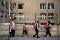 Mohammed Haitham Obeidi, 7, is seen walking with his mother and sisters to the first day of school in Amman, Jordan, Aug. 20, 2007. The family fled Iraq after threats were made on his father's life. They are now awaiting asylum.
