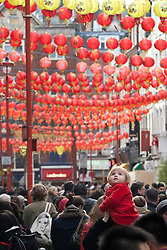 © licensed to London News Pictures. London, UK 22/01/12. People fill Chinatown in London for shopping and sharing the excitement of Chinese New Year on the day before Chinese New Year's Eve.. Photo credit: Tolga Akmen/LNP