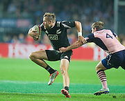 Phil Michelson breaks a Scottish tackle during the Hong Kong Sevens 2015 match between New Zealand and Scotland at Hong Kong Stadium, Hong Kong on 27 March 2015. Photo by Ian Muir....during the Hong Kong Sevens 2015 match between ........... at Hong Kong Stadium, Hong Kong on 27 March 2015. Photo by Ian Muir.