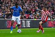 Chris Maguire of Sunderland (7) and Omar Bogle of Portsmouth (22) in action during the EFL Sky Bet League 1 first leg Play Off match between Sunderland and Portsmouth at the Stadium Of Light, Sunderland, England on 11 May 2019.