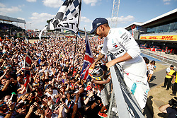 Mercedes' Lewis Hamilton greets the crowd after the 2018 British Grand Prix at Silverstone Circuit, Towcester.
