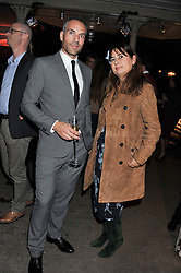 ADAM THOMAS Vertu Global PR Director and ALEXANDRA SHULMAN at a party to celebrate the launch of the new Vertu Constellation phone - the luxury phonemakers first touchscreen handset, held at the Farmiloe Building, St.John Street, Clarkenwell, London on 24th November 2011.