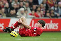 Photo:Ryan Browne/Back Page Images.<br />Liverpool v Chelsea, FA Barclays Premiership, Anfield, 01/01/05<br />Xabi Alonso holds his foot in pain