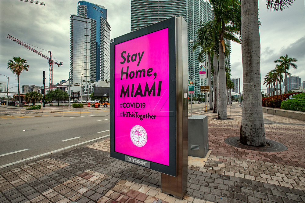 A digital public service announcement is displayed at a bus stop along Biscayne Boulevard in downtown Miami by the City of Miami urging residents to stay home due to COVID19 pandemic on Wednesday, April 1, 2020.