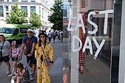 Now that most restrictions have come to an end, Oxford Street shopping district is busier than much of the last 18 months as shoppers return in their droves and retail business looks set to bounce back, although some shops have had to close down on 10th August 2021 in London, United Kingdom. Many people are wearing face masks in crowded places like this but they are no longer mandatory, while government advice suggests that it is advised to wear a face covering in busy public places inside and on transport, many people are still wearing them outside.