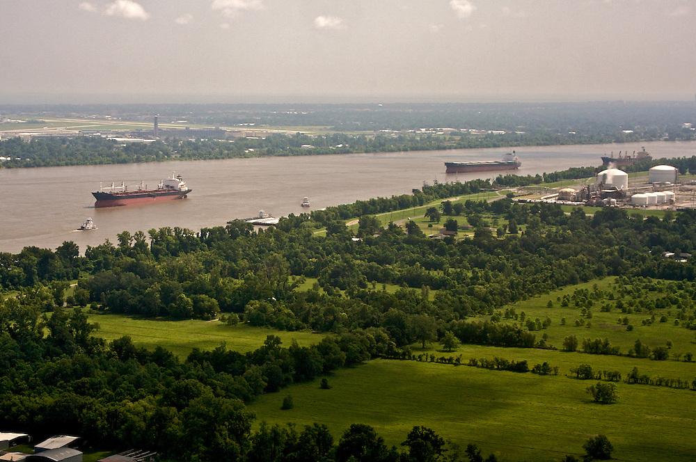 Ships head upriver on the Mississippi River at Ama, St. Charles Parish, Louisiana, USA