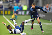 May 16, 2021 - Kansas City, KS, United States:   Vancouver Whitecaps forward Cristian Dajome (11, left) falls to the turf after colliding with Sporting Kansas City midfielder Ilie Sanchez (6). Sporting KC beat the Vancouver Whitecaps FC 3-0 in a Major League Soccer game. <br /> Photo by Tim Vizer/Polaris