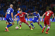 Aron Gunnarsson of Cardiff city © breaks away from Kevin Bru of Ipswich. Skybet football league championship match, Cardiff city v Ipswich Town at the Cardiff city stadium in Cardiff, South Wales on Tuesday 21st October 2014<br /> pic by Andrew Orchard, Andrew Orchard sports photography.