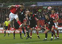 Photo: Steve Bond/Richard Lane Photography. Nottingham Forest v Doncaster Rovers. Coca Cola Championship. 28/11/2009. Paul Anderson (L) heads goalwards