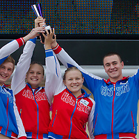 Members of Team Russia celebrate with the nations' trophy after winning the points competition in the Junior category during the FINA World Junior Open Water Swimming Championships in Balatonfured (about 132 km South-West from capital city Budapest), Hungary on September 07, 2014. ATTILA VOLGYI