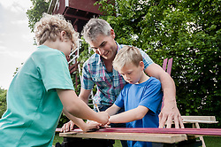 Teamwork father sons wood working building