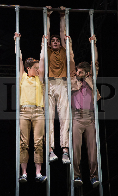 """© Licensed to London News Pictures. 10/01/2013. London, England. L-R: Charlotte Mooney, Luke Horley and Alex Harvey. """"Not Until We Are Lost"""", performed by the aerial theatre group """"Ockham's Razor"""" for the start of the London International Mime Festival 2013 at the new Platform Theatre King's Cross. The London International Mime Festival (LIMF'13) runs from 10 to 27 January 2013. Performers: Alex Harvey (red T-shirt), Luke Horley (brown T-shirt), Tina Koch (blue T-shirt) and Charlotte Mooney (yellow T-shirt). Photo credit: Bettina Strenske/LNP"""