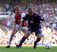 Picture: Henry Browne<br />Date: 13/09/2003<br />Arsenal v Portsmouth  FA Barclaycard Premiership<br /><br />Nigel Quashie of Portsmouth holds off Ray Parlour of Arsenal