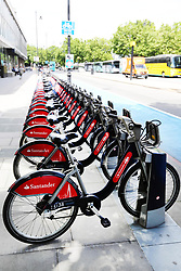 EDITORIAL USE ONLY<br /> General view of Santander branded cycle hire bikes on Millbank, London.