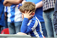 a Young Sheffield Wednesday fan looks on dejected after full time as his team loses the final. Skybet football league Championship play off final match, Hull city v Sheffield Wednesday at Wembley Stadium in London on Saturday 28th May 2016.<br /> pic by John Patrick Fletcher, Andrew Orchard sports photography.