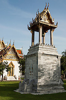 Bell Tower at Wat Benchamabophit - Wat Benchamabophit Dusitvanaram is also known as the marble temple and one of Bangkok's most beautiful temples typifying the ornate Thai style of gables, step roofs and elaborate details.  Construction of the temple began in 1899 at the request of King Chulalongkorn to be near his palace nearby. A picture of the temple's facade is on the Thai five baht coin.