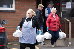 © Licensed to London News Pictures. 30/03/2020. Baddesley, North Warwickshire, UK. MP Delivery. Pictured, Angie Spencer, left) with volunteers. North Warwickshire MP Craig Tracey turns delivery man to help deliver meals in his constituency. When Atherstone coffee shop owner Angie Spencer decided to make meals for people who were housebound she asked for volunteers to help deliver the meals. The local community responded along with local MP Craig Tracey. The meals will be delivered on Mondays and Fridays to start with, the first going out today (Monday 30th March) with over 100 meals being delivered. Angie has put out a request for more drivers should the need rise. Angie, a local town councillor started the idea along with business partner Stephen Reay and asked Warwickshire County Council to help with the scheme. Photo credit: Dave Warren / LNP