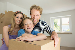 Young family happy new home smiling moving in