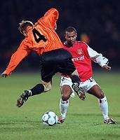 Ashley Cole (Arsenal) Anatolii Tymoschuk (Shakhtar Donetsk). Shakhtar Donetsk 3:0 Arsenal, UEFA Champions League, Group B, Centralny Stadium, Donetsk, Ukraine, 7/11/2000. Credit Colorsport / Stuart MacFarlane.