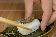 """Privet hawk moth larva sushi. Tokyo resident Shoichi Uchiyama is the author of """"Fun Insect Cooking"""". His blog on the topic gets 400 hits a day. He believes insects could one day be the solution to food shortages, and that rearing bugs at home could dispel food safety worries."""