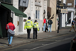 © Licensed to London News Pictures. 30/08/2020. London, UK. Police patrol the streets of Notting Hill, West London, on the day of the 2020 Notting Hill Carnival which is bing held virtually this year due to COVID-19 restrictions. Members of the public have been warned against congregating in the Notting Hill Area to celebrate the event. Photo credit: Ben Cawthra/LNP