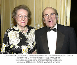 LORD & LADY OAKSEY at a dinner in London on 14th November 2001.OUF 26