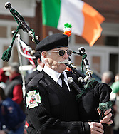 Goshen, New York - A member of the FDNY Retirees Pipes and Drums wears traditional dress while marching in the mid-Hudson St. Patrick's Day parade on March 13, 2011.