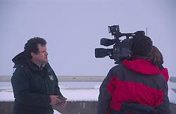 Television News Crew Interviews Monument Scientist Peter Frenzen at Johnston Ridge, Mt. St. Helens National Volcanic Monument, Washington, US, December 2004