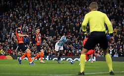 Manchester City's Raheem Sterling (centre) goes down inside the box, resulting in a penalty during the UEFA Champions League match at the Etihad Stadium, Manchester.