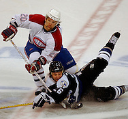 Hillsborough, Tampa, Fl 4/25/04-- BOLTS 26 --  Tampa Bay Lightning Martin St. Louis (#26) and Montreal Canadiens Richard Zednik (20) battle for the puck  in the second period of play during game 2 Eastern Conference Semi-Final at the Forum Sunday, April 25, 2004. PHOTOS 7 OF  IMAGES STAFF MICHAEL SPOONEYBARGER