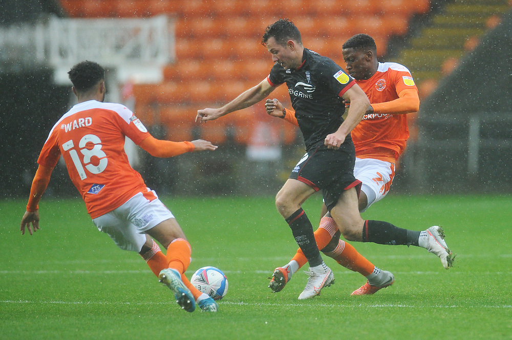 Lincoln City's Tom Hopper under pressure from Blackpool's Marvin Ekpiteta and Grant Ward<br /> <br /> Photographer Kevin Barnes/CameraSport<br /> <br /> The EFL Sky Bet League One - Blackpool v Lincoln City - Saturday 3rd October 2020 - Bloomfield Road - Blackpool<br /> <br /> World Copyright © 2020 CameraSport. All rights reserved. 43 Linden Ave. Countesthorpe. Leicester. England. LE8 5PG - Tel: +44 (0) 116 277 4147 - admin@camerasport.com - www.camerasport.com