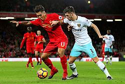 Roberto Firmino of Liverpool and Aaron Cresswell of West Ham United - Mandatory by-line: Matt McNulty/JMP - 11/12/2016 - FOOTBALL - Anfield - Liverpool, England - Liverpool v West Ham United - Premier League