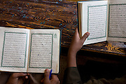 An aerial view of schoolboys reading Arabic verses from the Koran in a classroom at the Islamic Koom al-Bourit Institute for Boys in the village of Qum (Koom), on the West Bank of Luxor, Nile Valley, Egypt.