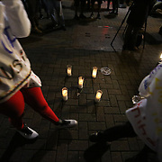 Charlotte, NC- September 22, 2016:  People walk passed a makeshift memorial in front of the for Justin Carr who was shot at the spot in front of the Omni Hotel the night before.  CREDIT: LOGAN R. CYRUS FOR THE NEW YORK TIMES